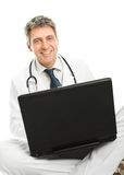 Medical doctor working on laptop Royalty Free Stock Images