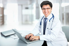 Medical doctor working with laptop Stock Photo