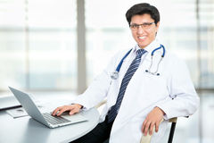 Medical doctor working with laptop Stock Photography