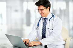 Medical doctor working with laptop Royalty Free Stock Photo