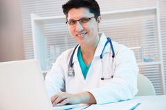 Medical doctor working with laptop Stock Image