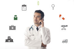 Medical Doctor working and use smartphone. Stock Photos