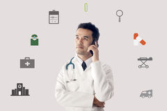 Medical Doctor working and use smartphone. Royalty Free Stock Photography