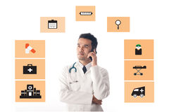 Medical Doctor working and use smartphone. Stock Image