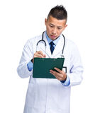Medical doctor write on clipboard Stock Images