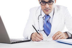 Medical doctor writes prescription on paper Royalty Free Stock Photo
