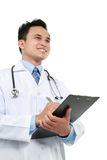 Medical doctor writing on clipboard Royalty Free Stock Photo
