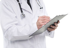 Medical doctor writing notes on the clipboard. Royalty Free Stock Image