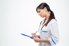 Medical doctor writing notes in clipboard Royalty Free Stock Photography