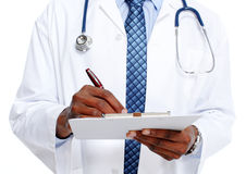 Medical doctor writing prescription. African-American Medical doctor writing prescription Royalty Free Stock Images