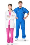 Medical doctors. Standing isolated. Young caucasian men or young asian women doctor professionals or nurses in medical scrubs isolated on white background Royalty Free Stock Photography