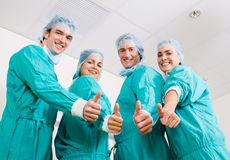 Medical doctors. A group young doctors puts hands thumbs up together forming a medical team sign stock images