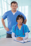 Medical doctors asian female and caucasian male Stock Photography