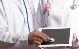 Medical doctors cheking tablet pc stock images