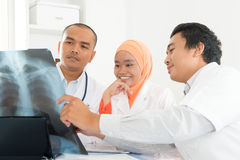 Medical doctors discussing on x-ray scan Stock Photo