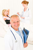 Medical doctors with hospital patient broken arm Royalty Free Stock Images