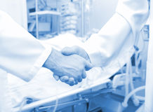 Medical doctors shaking hands Royalty Free Stock Images