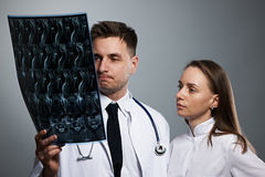 Medical doctors team with MRI spinal scan Stock Photo