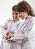 Medical doctors using tablet pc Royalty Free Stock Images