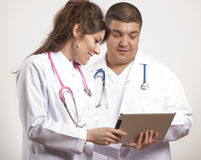 Medical doctors using tablet pc Stock Photo