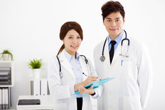 Medical doctors working in a hospital office. Male and female medical doctors working in a hospital office stock photography