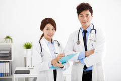 Medical doctors working in a hospital office. Male and female medical doctors working in a hospital office royalty free stock photography