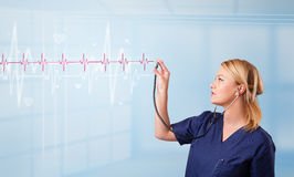 Medical doktor listening to red pulse Royalty Free Stock Image