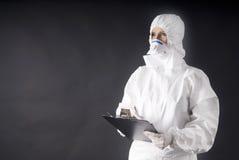Medical dress for biologic danger, swine or A flu. In black royalty free stock photos