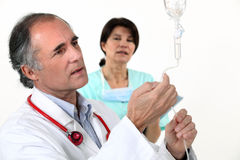 Medical drip. Beig checked by doctor Royalty Free Stock Image