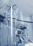 Medical drip in ICU on the background of equipment Royalty Free Stock Photography