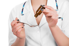Medical drops in spoon Royalty Free Stock Image