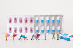 Medical drug capsule and miniature people Stock Photo