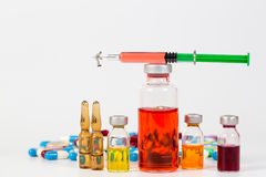 Medical drug with miniature people Stock Images