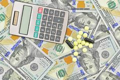 Medical drugs, calculator and U.S. dollars. Close-up Royalty Free Stock Image
