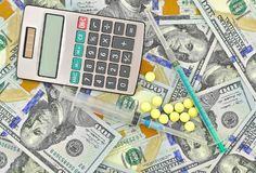Medical drugs, calculator and U.S. dollars. Close-up Royalty Free Stock Photo