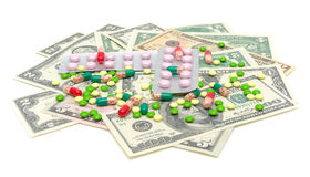 Medical drugs and money on a white background Royalty Free Stock Photography