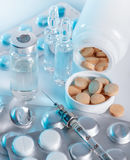 Medical drugs and syringe closeup Stock Images