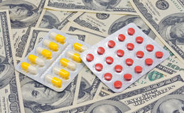Medical drugs and U.S. dollars Stock Photos