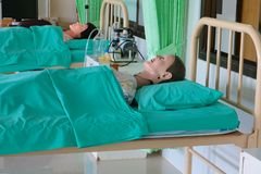 Medical dummy in hospital, training Medical course education on bed and blanket green stock images