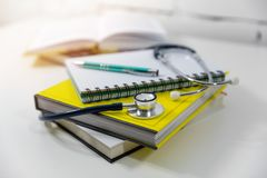 Medical education - medicine books and notes royalty free stock photos