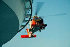 Medical Emergency. A Coast Guard Helicopter landing on top of cruise ship royalty free stock photography