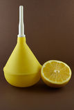 Medical enema with lemon on brown Stock Images
