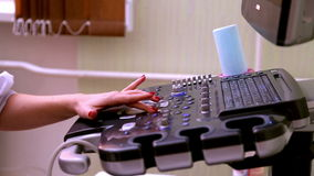 Medical equipment. Girl working on ultrasound equipment. Female hands control of medical equipment stock video footage