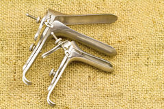 Medical equipment ,Gynecologic Speculum on brown sack fabric bac Royalty Free Stock Image