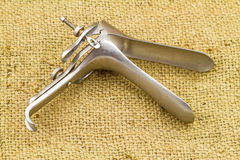 Medical equipment ,Gynecologic Speculum on brown sack fabric Royalty Free Stock Images