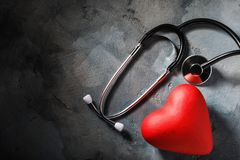Medical equipment and heart-shaped object on the table with copy space. Top view royalty free stock image