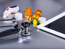 Medical equipment and medicine on stainless steel exam table Royalty Free Stock Images