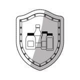 Medical equipment on shield Stock Photos