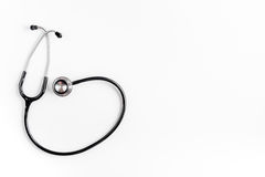 Medical equipment with stethoscope in doctor`s office on white desk background top view mock-up Stock Image
