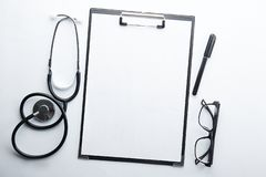 Medical equipment and technology concept. Case history and stethoscope stock image